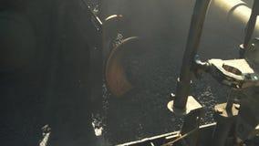 Machine is laying asphalt. stock video
