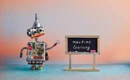Machine learning concept. Robot creative design toy metal funnel hopper, cogs wheels gears metallic body. Black Royalty Free Stock Image