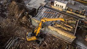 Machine is lifting lumber on a wood factory. bird`s eye view stock photos