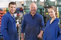 machine machinists talking three workspace Στοκ Φωτογραφίες