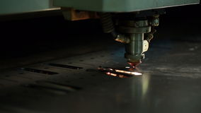 Machine makes hole in metal sheet by laser head stock video