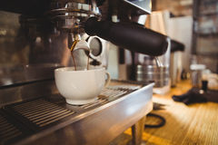 Machine making a cup of coffee Royalty Free Stock Photography