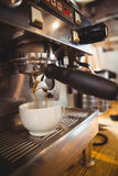 Machine making a cup of coffee Stock Photography