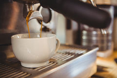 Machine making a cup of coffee Royalty Free Stock Photo