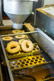 Machine making donuts. Close up of the machine making donuts Stock Photography