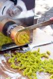 Machine making pasta Stock Photo