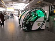 Machine for massages, relaxation, zen, rest. green plastic massage and relaxation system inside the schiphol amsterdam airport royalty free stock photos