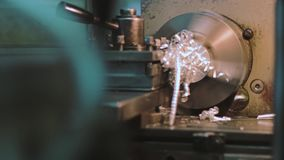 Machine and metal shavings. ProResHQ codec - Great for editing, color correction stock footage