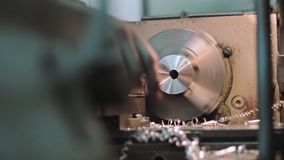 Machine and metal shavings. ProResHQ codec - Great for editing, color correction stock video footage