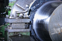 Machine with metal-working coolant. Operation of shaping metal piece machine with metal-working coolant Stock Image