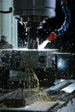 Machine with metal-working coolant. Operation of shaping metal piece machine with metal-working coolant Stock Images
