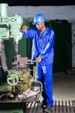 Machine operator. African american machinist operator operating a drilling machine Royalty Free Stock Photo