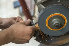 The machine operator regrinding the drill tool Royalty Free Stock Photography