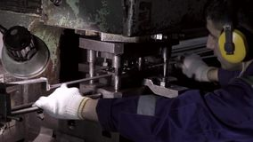 Machine operator works in a factory and stamps metal products stock footage