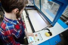Machine Operator in Workshop Stock Photo