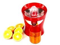 Machine for orange juice. A orange juice machine and glass Royalty Free Stock Photos