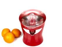 Machine for orange juice. A orange juice machine and orange Royalty Free Stock Images