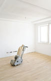 Machine for parquet floor polishing. The grinding machine for wooden parquet floors on a oak parquet stock photo
