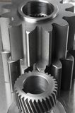 Machine-part-concept. Gears against large cog-wheels Stock Photos