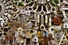 Machine parts background. Abstract background of differently assembled metal machine parts Stock Photography