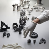 Machine parts and hand. Various machine parts and hardware Royalty Free Stock Images