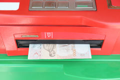 Machine payout of ATM. Machine payout of ATM and have Banknotes of Thai baht money payout Royalty Free Stock Images