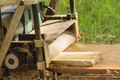 Machine planning a piece of wood. Royalty Free Stock Images