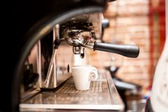 Machine preparing espresso in coffee shop royalty free stock image