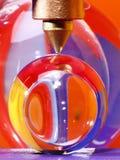 Machine press and glass balls Stock Photo