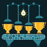 The machine produces Golden trophy cups under the electric light stock illustration