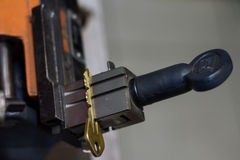 Machine production of duplicate metal key. Royalty Free Stock Photos