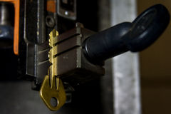 Machine production of duplicate metal key. Stock Images