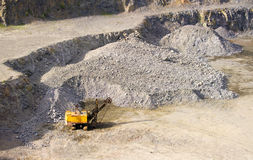 Machine at the quarry for the extraction of granite Stock Image