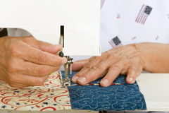 Machine quilting. A woman sews panels together for use on a tote bag Royalty Free Stock Photo