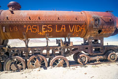 Machine on railway. Large iron machine on railway surrounded by lonely plains near Salar de Uyuni in Bolivia Stock Photos