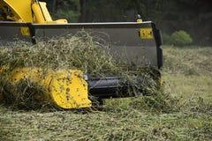 Machine for raking hay and grass. Royalty Free Stock Image