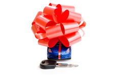The machine with a red bow isolated on white background. Gift Royalty Free Stock Images