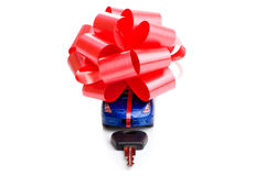 The machine with a red bow isolated on white background. Gift Royalty Free Stock Image