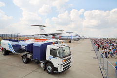 Machine for refueling, aircraft, and crowd Stock Photos