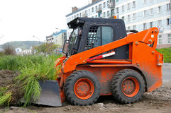 The Machine for removing sod. Machine for removing sod orange colour, is used for landscape of design royalty free stock photo