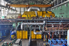 Machine room in thermal power plant with generators and turbines. Machine room in thermal power plant with electric generators and turbines Royalty Free Stock Photography