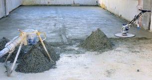 Machine running screed flooring. Construction site - machine running screed flooring Stock Photo