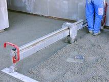 Machine running screed flooring. Construction site - machine running screed flooring Stock Photos
