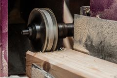 Close up of a straight router bit cutting a groove or rabbet in a piece of oak. The machine for sampling the groove in a wooden beam with a milling cutter for royalty free stock images