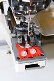 Machine for sewing on buttons of electric type Stock Photo