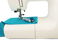 Machine sews with blue textile fabric Stock Photography