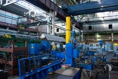Machine shop of metallurgical works indoors room. Shop blacksmithing plant. Industrial tourism royalty free stock photography
