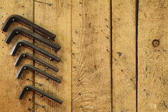 Machine shopbackground with copy space on right. A wooden wall panel with allen key bits hung on nails stock photo