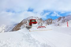 Machine for skiing slope preparations at Kaprun Austria. Nature and sport background Royalty Free Stock Photo