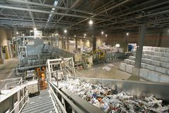 Machine for sorting and washing waste paper - paper recycling an. D production in a mill royalty free stock photography